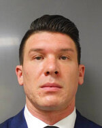 This June 6, 2020 photo provided by the Erie County District Attorney's Office in Buffalo, N.Y., shows suspended Buffalo police officer Robert McCabe. Prosecutors say McCabe was charged with assault Saturday, June 6, 2020, after a video showed him and another officer shoving a 75-year-old protester on Thursday, June 4, in a recent demonstration over the death of George Floyd in Minnesota. (Erie County District Attorney's Office via AP)