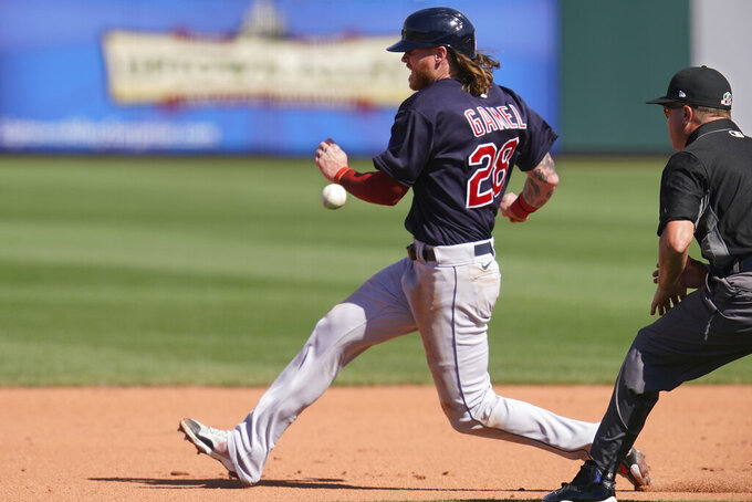 Cleveland Indians' Ben Gamel races the ball thrown by catcher Drew Butera to shortstop Isiah Kiner-Falefa at second base, on an attempted steal during the fifth inning of a spring training baseball game Tuesday, March 9, 2021, in Surprise, Ariz. Gamel was out on the play. (AP Photo/Sue Ogrocki)
