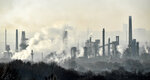 A BP oil refinery is at work in Gelsenkirchen, Germany, on Wednesday morning, Dec. 4, 2019.  The UN Climate Change Conference COP 25 takes place in Madrid until Dec. 13, 2019 under the Presidency of the Government of Chile with logistical support from the Government of Spain. (AP Photo/Martin Meissner)