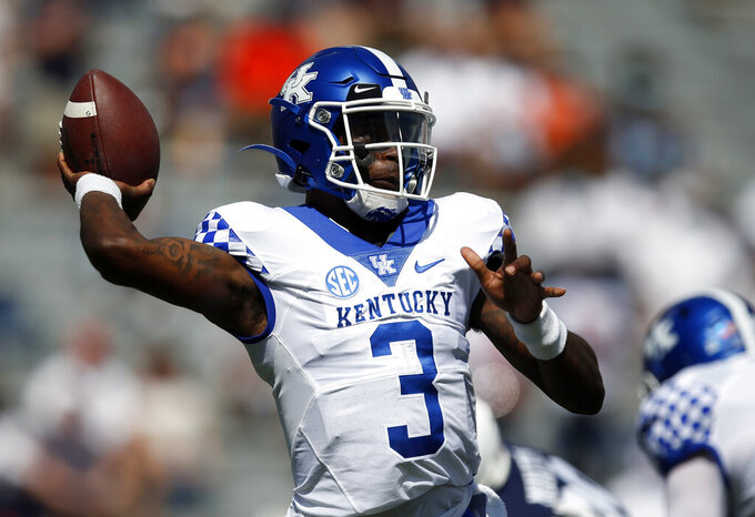 Kentucky quarterback Terry Wilson (3) throws a pass against Auburn during the first quarter of an NCAA college football game on Saturday, Sept. 26, 2020 in Auburn, Ala. (AP Photo/Butch Dill)