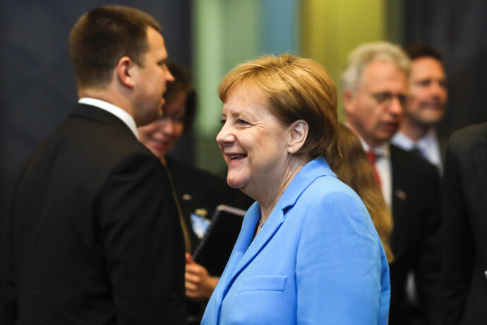 German Chancellor Angela Merkel arrives for a working session during a summit of heads of state and government at NATO headquarters in Brussels on Wednesday, July 11, 2018. (AP Photo/Markus Schreiber)