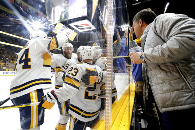 Nashville Predators players and fans celebrate after a goal by Craig Smith (15) in the second period of an NHL hockey game against the St. Louis Blues, Sunday, Feb. 16, 2020, in Nashville, Tenn. (AP Photo/Mark Humphrey)