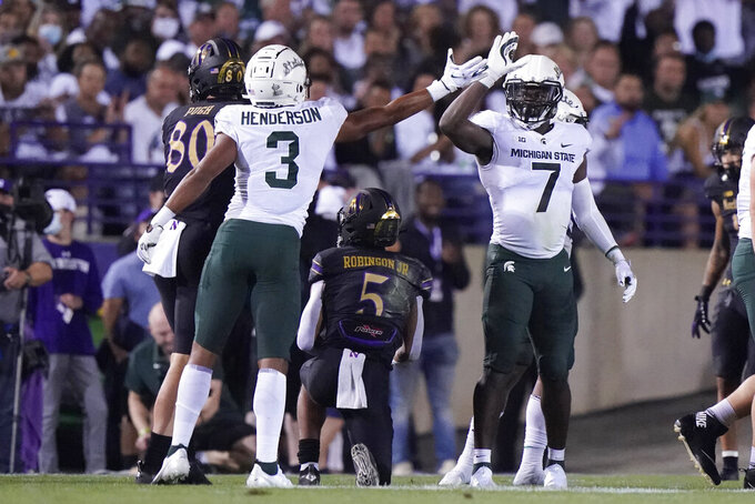 Michigan State safety Xavier Henderson (3) celebrates with safety Michael Dowell (7) after Henderson tackled Northwestern wide receiver Stephon Robinson Jr. (5) during the first half of an NCAA college football game in Evanston, Ill., Friday, Sept. 3, 2021. (AP Photo/Nam Y. Huh)