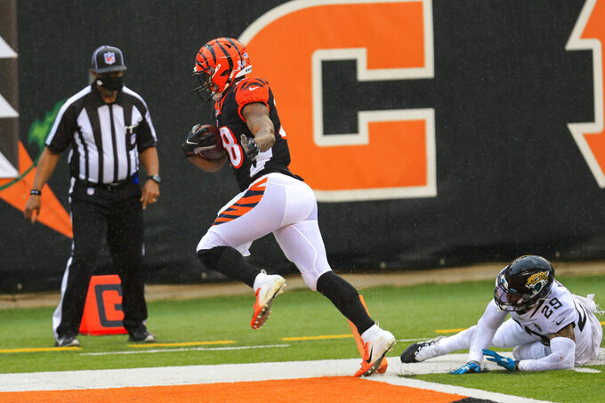 Cincinnati Bengals running back Joe Mixon (28) runs in for a touchdown in front of Jacksonville Jaguars strong safety Josh Jones (29) in the second half of an NFL football game in Cincinnati, Sunday, Oct. 4, 2020. (AP Photo/Aaron Doster)