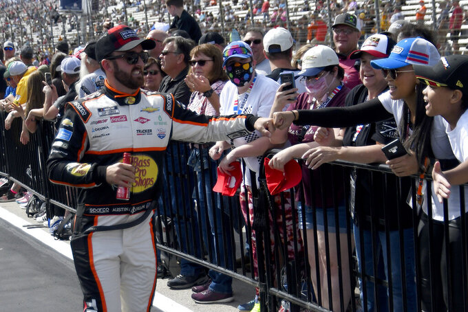 Driver Austin Dillon greets fans before a NASCAR Cup Series auto race at Texas Motor Speedway Sunday, Oct. 17, 2021, in Fort Worth, Texas. (AP Photo/Randy Holt)