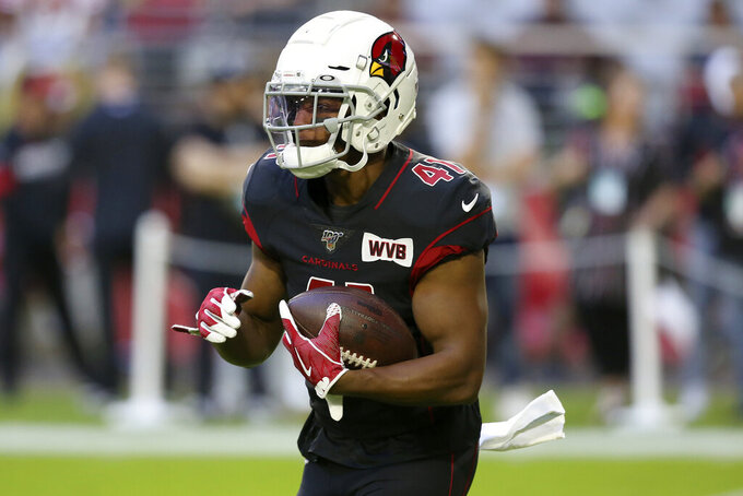 Arizona Cardinals running back Kenyan Drake warms up prior to an NFL football game against the San Francisco 49ers, Thursday, Oct. 31, 2019, in Glendale, Ariz. (AP Photo/Ross D. Franklin)
