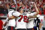 Tampa Bay Buccaneers' Ryan Succop (3) celebrates with Pat O'Connor (79) and Bradley Pinion (8) after kicking what proved to be the game-winning field goal during the second half of an NFL football game against the Dallas Cowboys Thursday, Sept. 9, 2021, in Tampa, Fla. (AP Photo/Scott Audette)