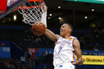 Oklahoma City Thunder forward Darius Bazley (7) dunks during the second half of the team's NBA basketball exhibition game against the New Zealand Breakers on Thursday, Oct. 10, 2019, in Oklahoma City. (AP Photo/Sue Ogrocki)