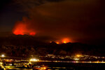 The Apple Fire burns behind mountains near Beaumont, Calif., Sunday, Aug. 2, 2020. (AP Photo/Ringo H.W. Chiu)