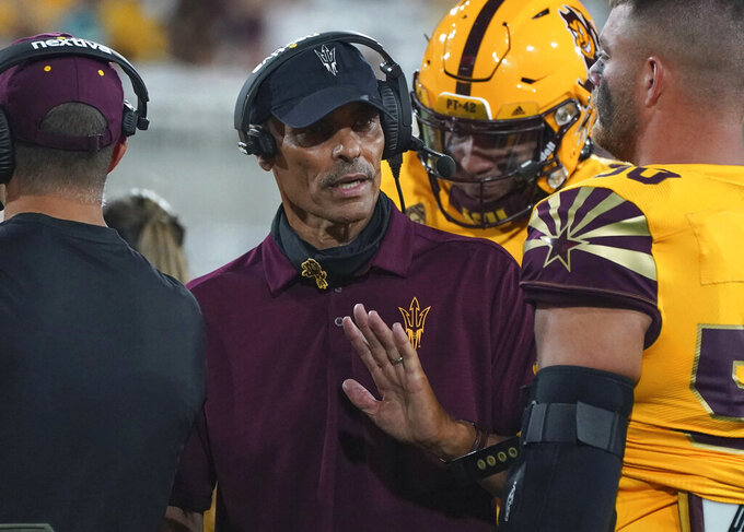 Arizona State head coach Hern Edwards talks to his offense during the second half of their game against Colorado in an NCAA college football game Sat, Sept 25, 2021, in Tempe, Ariz. (AP Photo/Darryl Webb)