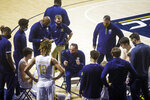 Notre Dame head coach Mike Brey talks to his team during a timeout in the first half of an NCAA college basketball game against Ohio State on Tuesday, Dec. 8, 2020, in South Bend, Ind. Ohio State won 90-85. (AP Photo/Robert Franklin)