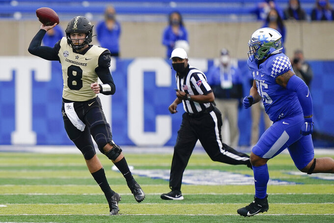 Vanderbilt quarterback Ken Seals (8) throws a pass during the second half of an NCAA college football game against Kentucky, Saturday, Nov. 14, 2020, in Lexington, Ky. (AP Photo/Bryan Woolston)