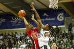 Georgia forward Christian Brown (3) shoots over Michigan State forward Xavier Tillman (23) during the first half of an NCAA college basketball game Tuesday, Nov. 26, 2019, in Lahaina, Hawaii. (AP Photo/Marco Garcia)