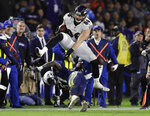 FILE - In this Dec. 22, 2018, file photo, Baltimore Ravens tight end Nick Boyle, top, leaps over Los Angeles Chargers outside linebacker Jatavis Brown during an NFL football game, in Carson, Calif. The Ravens have signed Nick Boyle to a three-year contract, the latest in a series of moves by first-year general manager Eric DeCosta during a busy offseason. Though Boyle has not scored a touchdown over his four NFL seasons, the 6-foot-4, 270-pounder has value that transcends catches and scores.(AP Photo/Marcio Jose Sanchez, File)