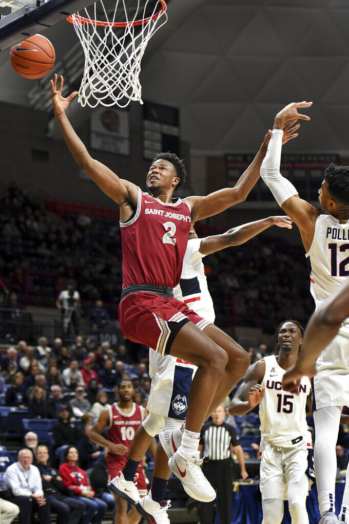 Saint Joseph's guard Cameron Brown (3) puts up the ball in the second half of an NCAA college basketball game against Connecticut Wednesday, Nov. 13, 2019, in Storrs, Conn. (AP Photo/Stephen Dunn)