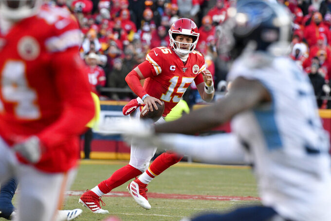 Kansas City Chiefs' Patrick Mahomes (15) runs for a touchdown during the first half of the NFL AFC Championship football game against the Tennessee Titans Sunday, Jan. 19, 2020, in Kansas City, MO. (AP Photo/Ed Zurga)