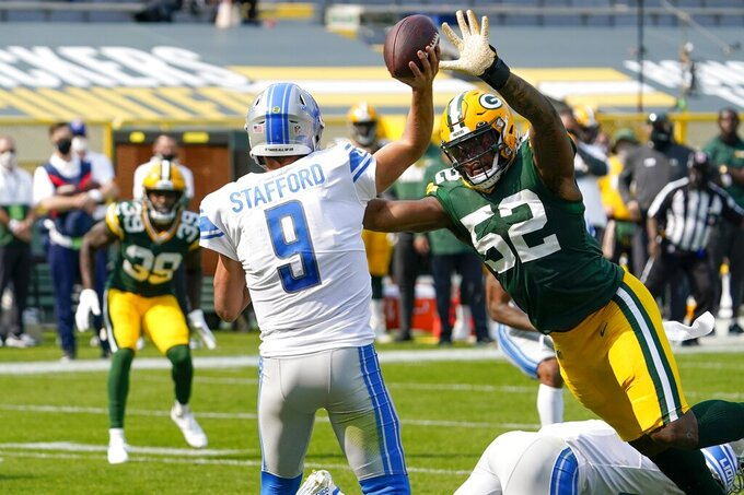 Detroit Lions' Matthew Stafford throws an interception to Green Bay Packers' Chandon Sullivan (39) during the second half of an NFL football game Sunday, Sept. 20, 2020, in Green Bay, Wis. (AP Photo/Morry Gash)