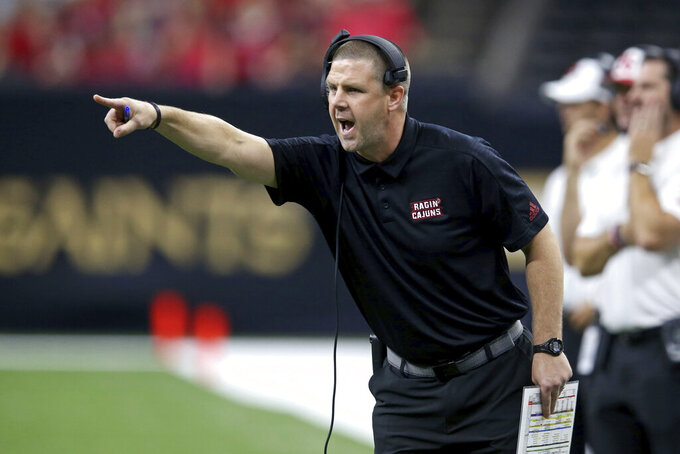 Louisiana-Lafayette head coach Billy Napier yells in the second quarter of an NCAA college football game against Mississippi State in New Orleans, Saturday, Aug. 31, 2019. (AP Photo/Chuck Cook)