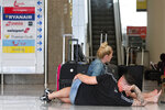 British passengers wait for news on cancelled Thomas Cook flights at Palma de Mallorca airport on Monday Sept. 23, 2019. Spain's airport operator AENA says that 46 flights have been affected by the collapse of the British tour company Thomas Cook, mostly in the Spanish Balearic and Canary archipelagos. (AP Photo/Francisco Ubilla)