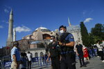 Turkish armed police officers, following Turkey's Council of State's decision, patrol outside the Byzantine-era Hagia Sophia, one of Istanbul's main tourist attractions in the historic Sultanahmet district of Istanbul, Friday, July 10, 2020. Turkey's highest administrative court issued a ruling Friday that paves the way for the government to convert Hagia Sophia - a former cathedral-turned-mosque that now serves as a museum - back into a Muslim house of worship. The Council of State threw its weight behind a petition brought by a religious group and annulled a 1934 cabinet decision that changed the 6th century building into a museum. (AP Photo/Emrah Gurel)