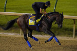 Kentucky Derby entry Thousand Words runs during an early morning workout at Churchill Downs, Friday, Sept. 4, 2020, in Louisville, Ky. The Kentucky Derby is scheduled for Saturday, Sept. 5th. (AP Photo/Charlie Riedel)