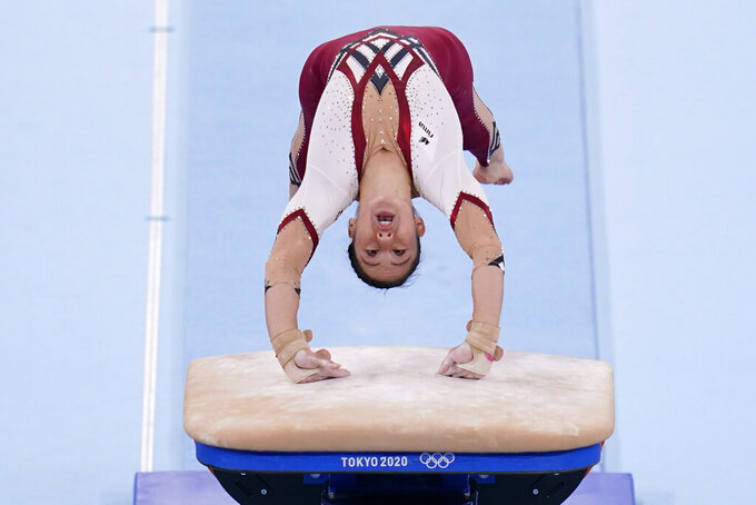 Kim Bui, of Germany, performs on the vault during the women's artistic gymnastic qualifications at the 2020 Summer Olympics, Sunday, July 25, 2021, in Tokyo. (AP Photo/Gregory Bull)