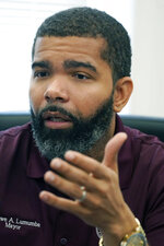 Jackson Mayor Chokwe A. Lumumba outlines how the city is working to meet the first round of deadlines laid out in an agreement with the U.S. government on how to improve the quality of drinking water in the Capital City, Thursday, July 22, 2021, in Jackson, Miss. (AP Photo/Rogelio V. Solis)