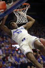 Kansas forward David McCormack (33) dunks during the first half of an NCAA college basketball game against Milwaukee in Lawrence, Kan., Tuesday, Dec. 10, 2019. (AP Photo/Orlin Wagner)