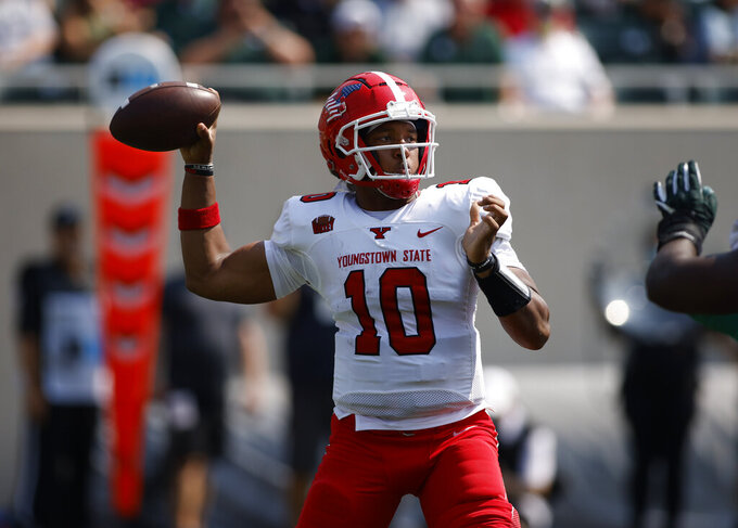 Youngstown State quarterback Demeatric Crenshaw throws a pass against Michigan State during the second quarter of an NCAA college football game, Saturday, Sept. 11, 2021, in East Lansing, Mich. (AP Photo/Al Goldis)