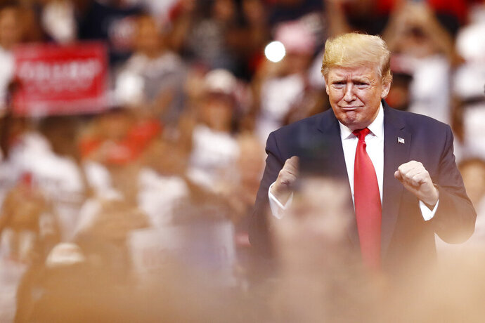 President Donald Trump reacts to the crowd before he speaks during a rally on Tuesday, Nov. 26, 2019, in Sunrise, Fla. (AP Photo/Brynn Anderson)
