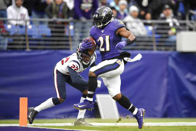 Baltimore Ravens running back Mark Ingram (21) scores on a touchdown run as Houston Texans cornerback Gareon Conley (22) tries to stop him during the second half of an NFL football game, Sunday, Nov. 17, 2019, in Baltimore. (AP Photo/Nick Wass)