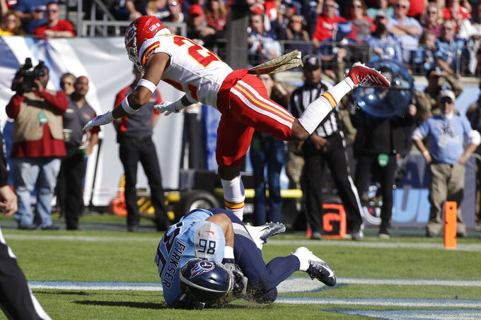 Tennessee Titans tight end Anthony Firkser (86) catches a touchdown pas as he is defended by Kansas City Chiefs free safety Juan Thornhill (22) in the first half of an NFL football game Sunday, Nov. 10, 2019, in Nashville, Tenn. (AP Photo/James Kenney)