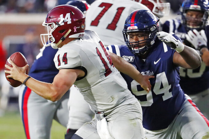 Mississippi defensive end Quentin Bivens (94) reaches out to sack New Mexico State quarterback Josh Adkins (14) during the second half of an NCAA college football game in Oxford, Miss., Saturday, Nov. 9, 2019. (AP Photo/Rogelio V. Solis)
