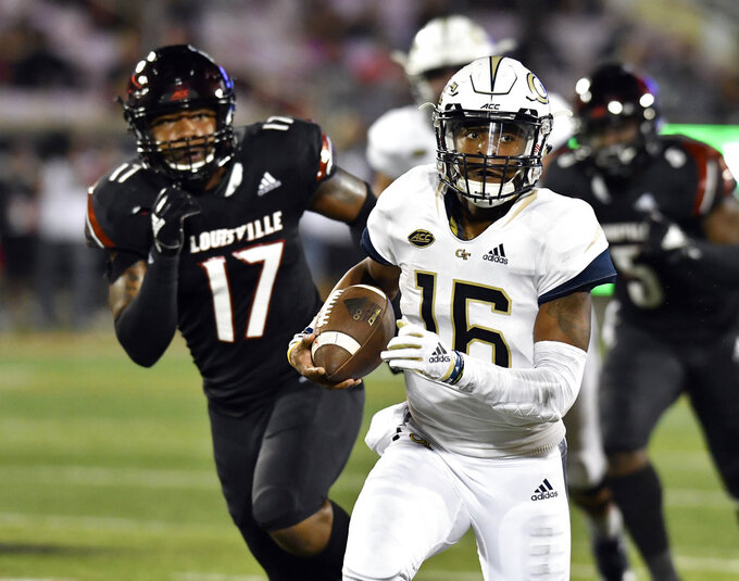 Georgia Tech quarterback TaQuon Marshall (16) runs from the pursuit of Louisville linebacker Dorian Etheridge (17) during the first half of an NCAA college football game, Friday, Oct. 5, 2018, in Louisville, Ky. (AP Photo/Timothy D. Easley)