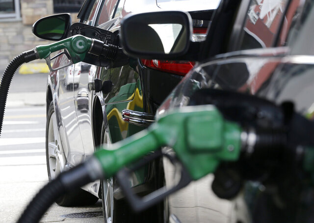 FILE - In this June 30, 2016 file photo, gas nozzles pump gas into vehicles at a BP gas station in Hoboken, N.J. Gas prices have increased a bit again in New Jersey and around the nation with supply and demand on what analysts call
