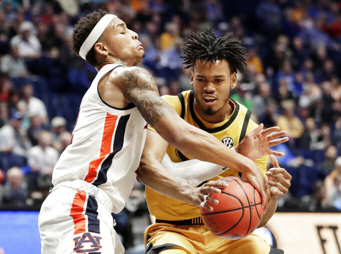 Auburn guard Bryce Brown, left, defends against Missouri guard Torrence Watson in the first half of an NCAA college basketball game at the Southeastern Conference tournament Thursday, March 14, 2019, in Nashville, Tenn. (AP Photo/Mark Humphrey)