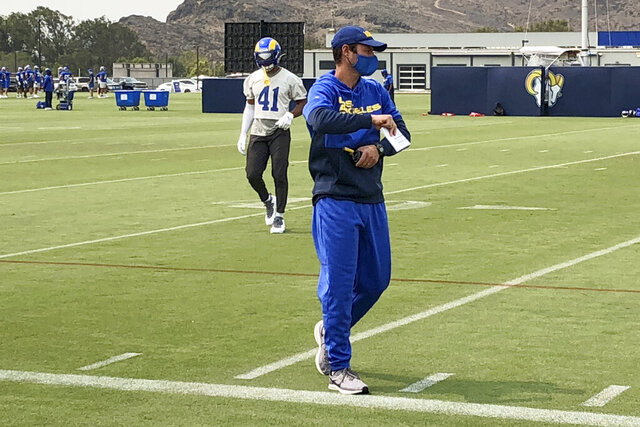 Los Angeles Rams defensive coordinator Brandon Staley watches football practice at the team's training complex in Thousand Oaks, California, on Friday, Sept. 11, 2020. Staley is in his first season as an NFL coordinator after a meteoric rise in his profession since 2016, when he was the defensive coordinator at Division III John Carroll University. (AP Photo/Greg Beacham)