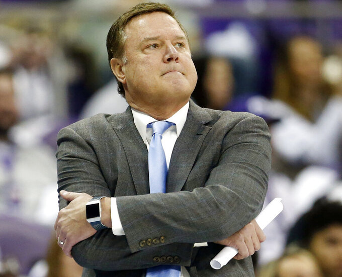Kansas head coach Bill Self looks on as Kansas plays TCU during the second half of an NCAA college basketball game, Saturday, Feb. 8, 2020 in Fort Worth, Texas. Kansas coach Bill Self was still trying to figure out the makeup of his team the first week of November, roughly about the time the Jayhawks would have had a couple exhibition games under their belt in anticipation of the season. (AP Photo/Ron Jenkins)