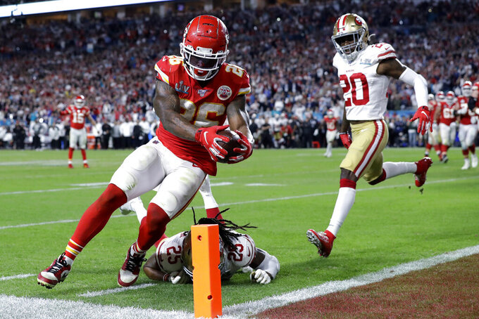 FILE - In this Feb. 2, 2020, file photo, Kansas City Chiefs' Damien Williams (26) scores a touchdown against the San Francisco 49ers during the second half of the NFL Super Bowl 54 football game in Miami Gardens, Fla. A total of 66 players have opted out of the 2020 NFL season due to the coronavirus pandemic, including Williams. (AP Photo/Mark Humphrey, File)