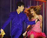 FILE- In this Feb. 8, 2004, file photo, Beyonce, right, and Prince perform during the 46th Annual Grammy Awards in Los Angeles. The two were paired together by long-time Grammys producer Ken Ehrlich, who hangs up his producer hat on Sunday.  (AP Photo/Kevork Djansezian, File)