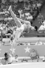 FILE - In this Aug. 4, 1984, file photo, Li Ning, of China, performs in the floor exercises in the gymnastics finals at the Summer Olympic Games in Los Angeles. (AP Photo/Suzanne Vlamis, File)