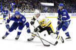 Tampa Bay Lightning defenseman Erik Cernak (81) knocks the puck away from Pittsburgh Penguins center Sidney Crosby (87) during the first period of an NHL hockey game Thursday, Feb. 6, 2020, in Tampa, Fla. Trailing the play is Tampa Bay's Anthony Cirelli (71). (AP Photo/Chris O'Meara)