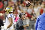 UCLA head coach Chip Kelly, center, shouts to his players during the first half of an NCAA college football game against Washington State in Pullman, Wash., Saturday, Sept. 21, 2019. (AP Photo/Young Kwak)