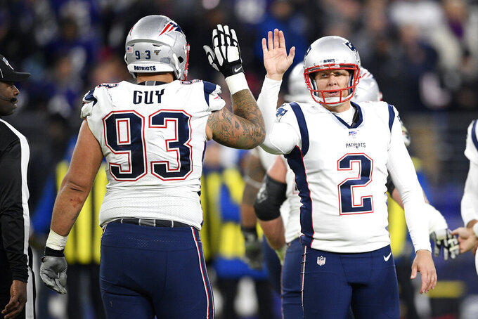 New England Patriots place kicker Nick Folk (2) celebrates his field goal against the Baltimore Ravens with defensive end Lawrence Guy (93) during the first half of an NFL football game, Sunday, Nov. 3, 2019, in Baltimore. (AP Photo/Nick Wass)
