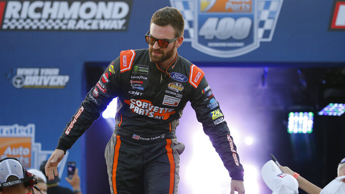 Corey LaJoie greets fans during driver introductions for the NASCAR Monster Energy Cup series auto race at Richmond Raceway in Richmond, Va., Saturday, Sept. 21, 2019. (AP Photo/Steve Helber)