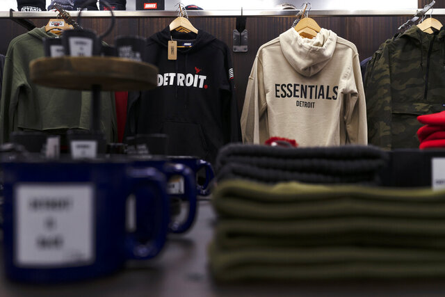 Clothing by local Detroit designers are displayed at Dose Collective, on Nov. 17, 2020, in Detroit, a new shop on Woodward Ave., where small shops can rent space for pop-ups. Tee Chapel is the owner of the space and it's her second location. (Antranik Tavitian/Detroit Free Press via AP)