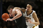 Minnesota's guard Amir Coffey and Purdue's Grady Eifert get wrapped up while going after the ball during the second half of an NCAA basketball game Tuesday, March 5, 2019, in Minneapolis. Minnesota won 73-69. (AP Photo/Stacy Bengs)