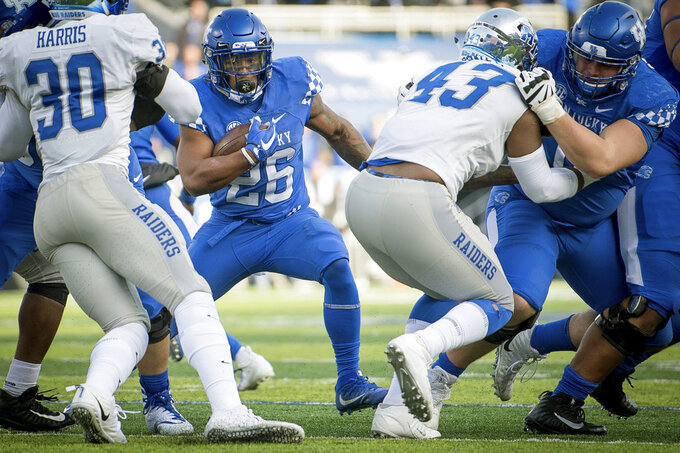 Kentucky running back Benny Snell Jr. (26) runs with the ball during the second half of an NCAA college football game against Middle Tennessee in Lexington, Ky., Saturday, Nov. 17, 2018. (AP Photo/Bryan Woolston)