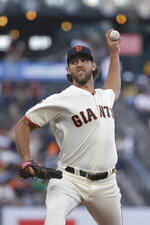 San Francisco Giants pitcher Madison Bumgarner throws to an Oakland Athletics batter during the first inning of a baseball game in San Francisco, Tuesday, Aug. 13, 2019. (AP Photo/Jeff Chiu)