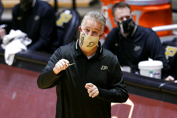 Purdue coach Matt Painter gestures during the first half of the team's NCAA college basketball game against Valparaiso on Friday, Dec. 4, 2020, in West Lafayette, Ind. (Nikos Frazier/Journal & Courier via AP)